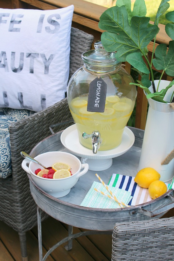 Love this industrial table and pretty lemonade bar!