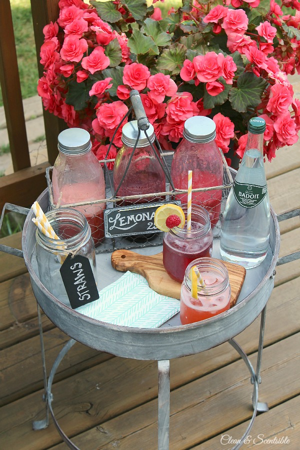 I love this industrial table and flavored lemonade bar!  Perfect for backyard relaxing!