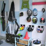 Garage Pegboard Organizer - This is such a great way to keep all of that sports gear organized and off the floor!