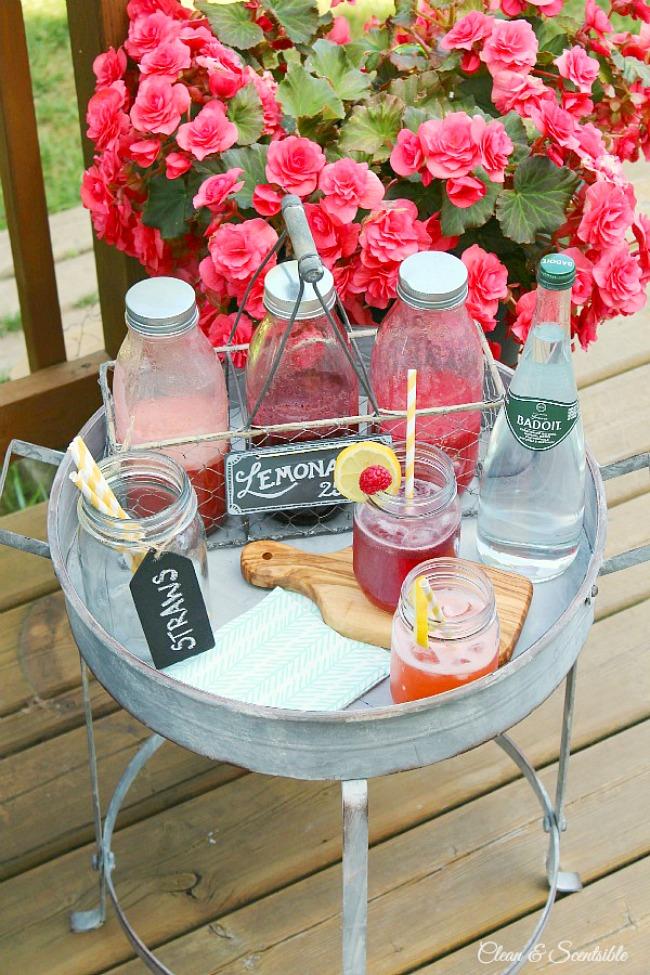 Flavored fruit syrups for a lemonade bar in glass bottles.