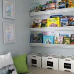 Love this cute reading nook! Encourage your kids to read with a comfy space and books that are easily accessible.