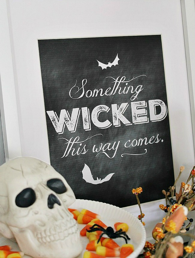 Something Wicked Comes This Way free chalkboard Halloween printable in frame.
