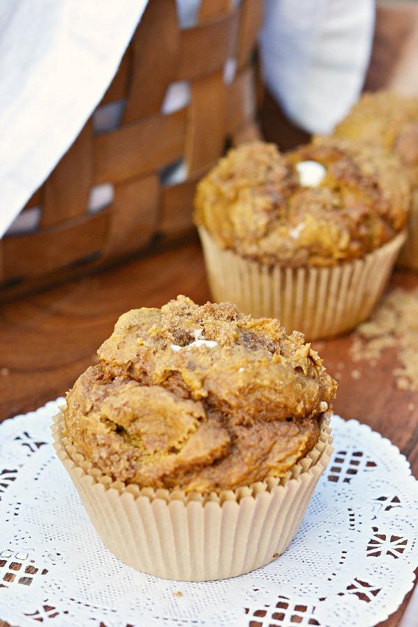 Pumpkin cream cheese muffins in a basket.