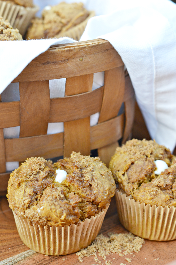 Pumpkin cream cheese muffins in a basket.