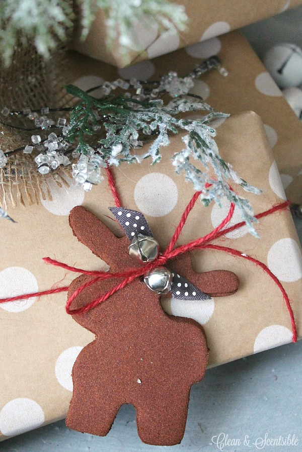 Make these cute cinnamon Christmas tree ornaments with only two ingredients! They also look super cute as gift toppers!