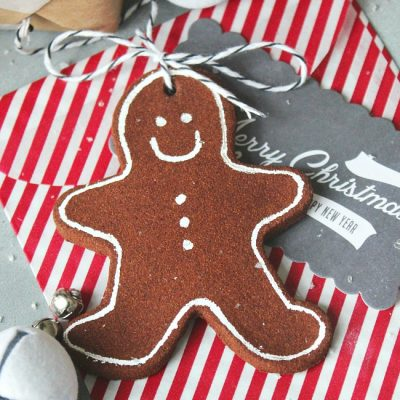 Cinnamon ornament gingerbread man used as a present topper.