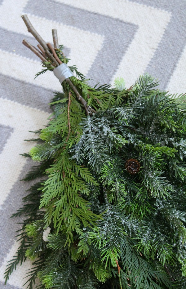Step by step tutorial to create a DIY Christmas swag wreath. Duct tape used to tie the ends together.
