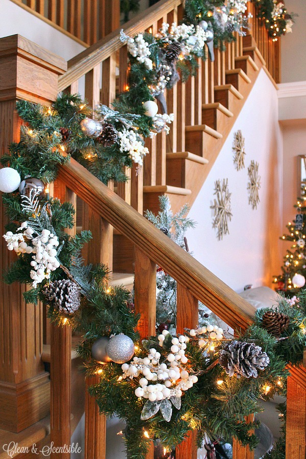 Great tips on how to put together a pretty Christmas garland and how to hang it from the stairs.