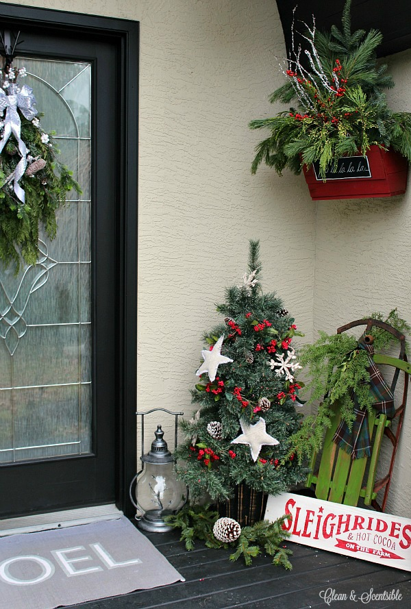 Rustic Christmas front porch with lots of decorating ideas and tutorials.