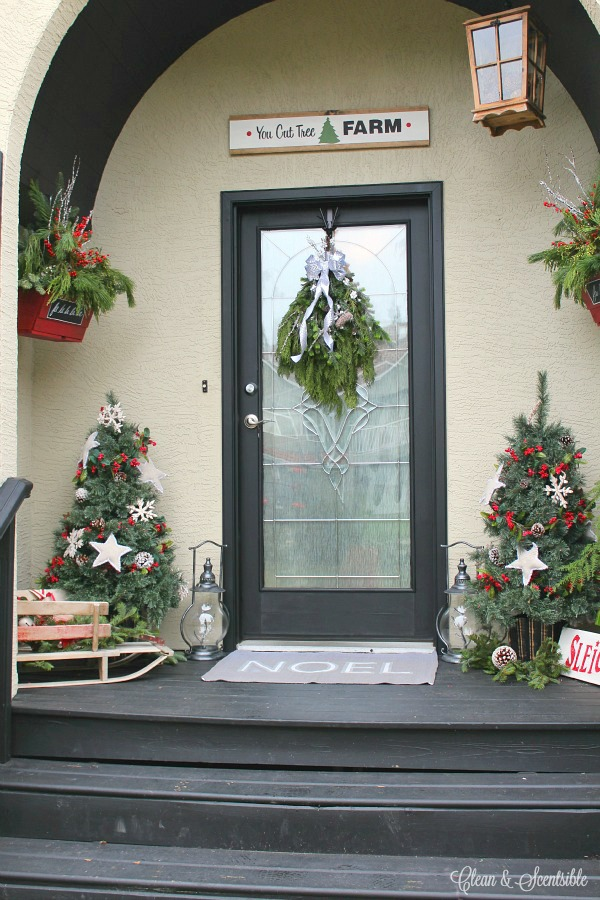 Rustic Christmas front porch with lots of decorating ideas and DIY tutorials.