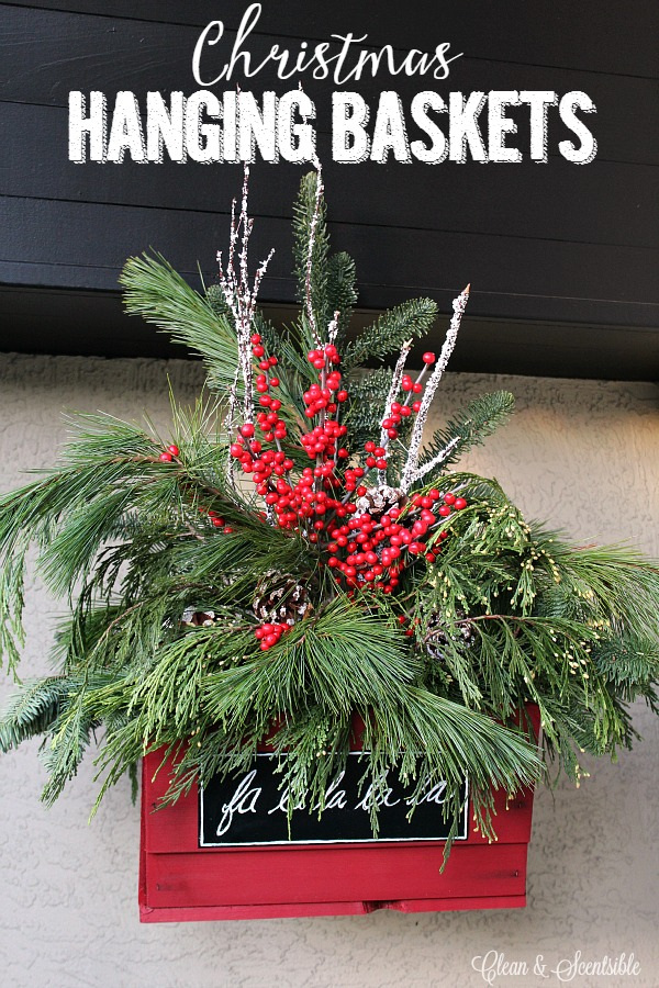 Pretty rustic Christmas hanging baskets with fresh greenery.