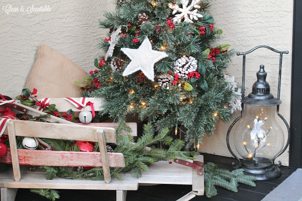 rustic christmas front porch with lots of decorating ideas and diy tutorials