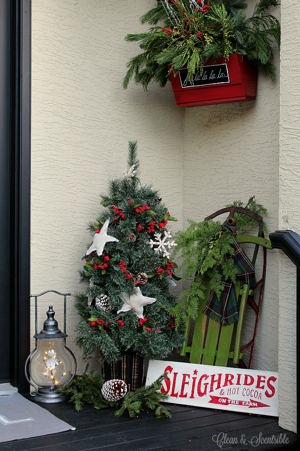 pretty rustic christmas hanging baskets with fresh greenery