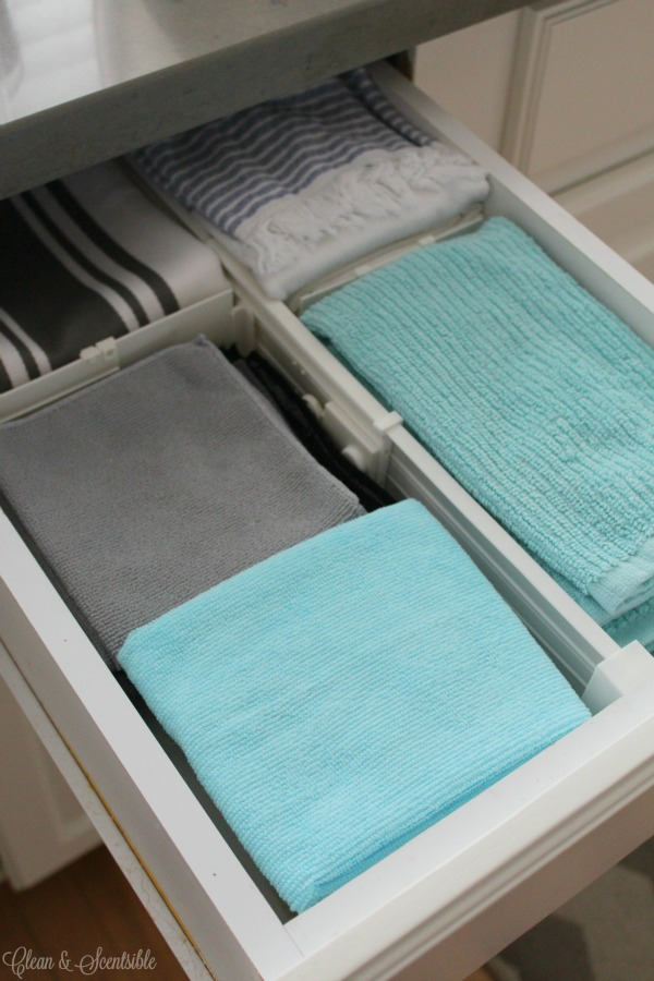 use drawer dividers to keep kitchen cleaning cloths organized