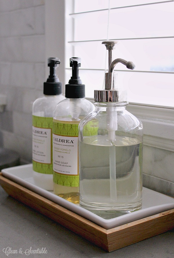Use a bathroom tray to chorale hand soap, lotion, and dish soap together on the kitchen counter.