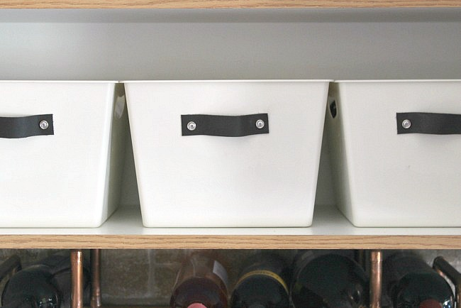 Dress up those boring dollar store bins with this easy tutorial for stylish DIY storage totes.