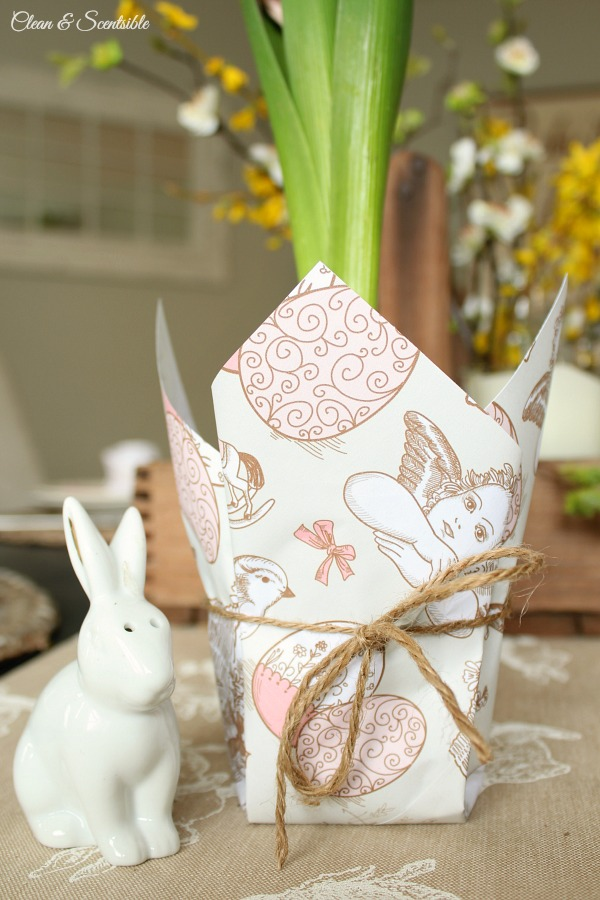 Wrap a flower pot with this cute Eater wrapping paper for inexpensive Easter decor. Free printable paper included.