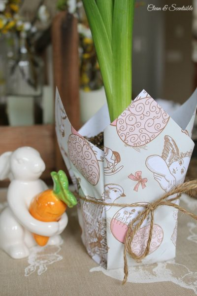 Cute Easter planter with free printable wrapping paper. This would make a great hostess gift or looks beautiful for some Easter decor.