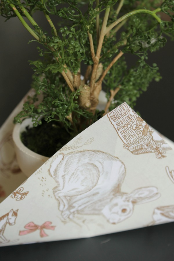 Add some gift wrap to a plant for that special touch. Free printable Easter paper included.