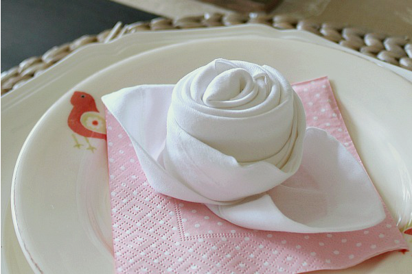 How to fold a napkin into a rose bud.