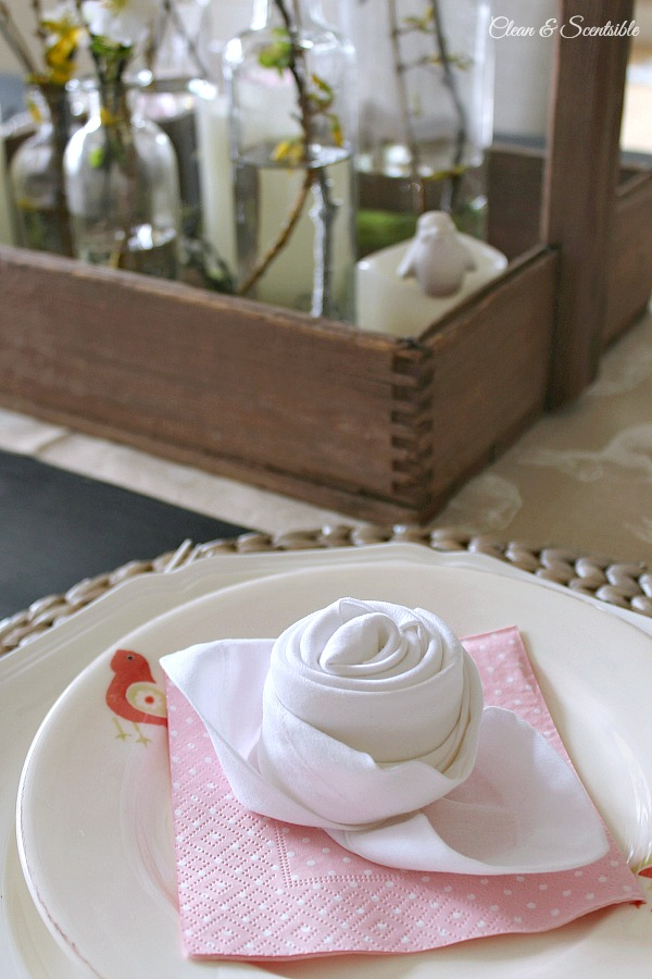 Easy tutorial to fold a napkin into a rosebud as well as other spring and Easter tablescape ideas.