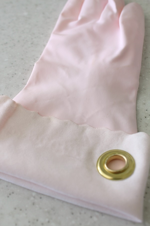 Add some grommets to your cleaning gloves or cleaning cloths so they can easily be hung up.