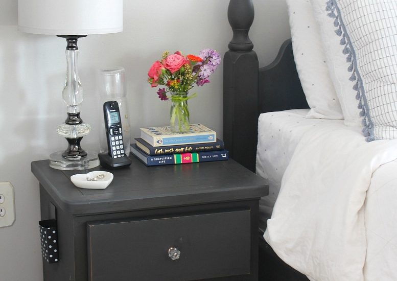 Black nightstand with flowers
