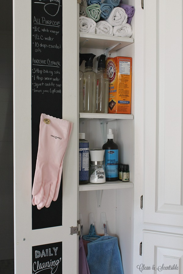 Love this organized cleaning closet - especially the chalkboard door for DIY green cleaning recipes!
