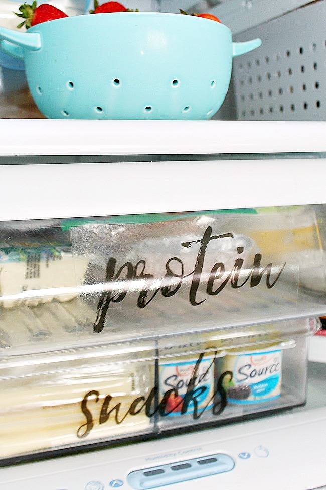 Free printable fridge labels on fridge bins.