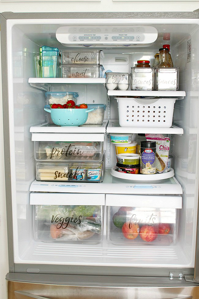 Organized fridge space with free printable fridge labels.