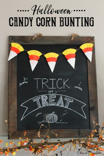 Candy corn bunting made from cupcake liners on a Halloween chalkboard.