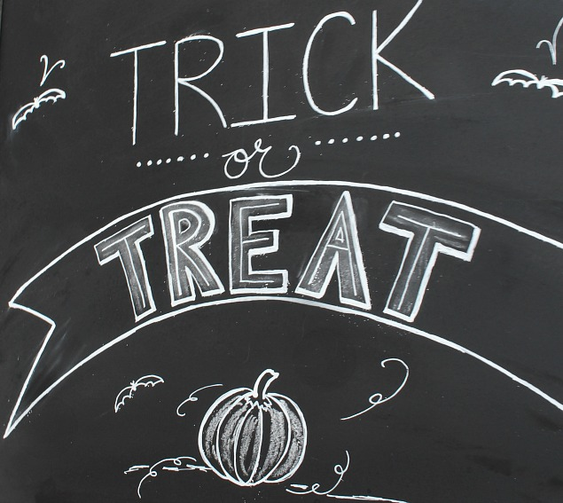 Halloween chalkboard and candy corn bunting.