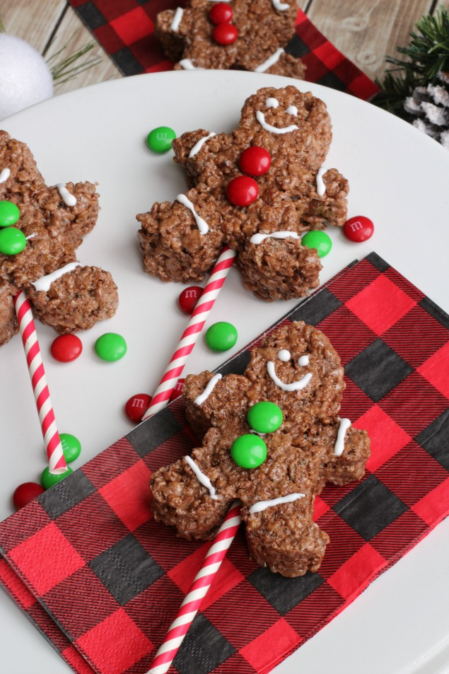Chocolate Rice Krispie gingerbread men on a colored popsicle stick. Fun Christmas treat!