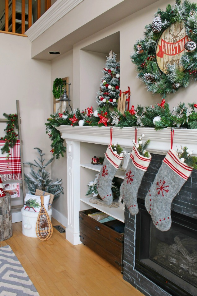 Cozy Christmas cabin Chirstmas mantel - snowy covered branches with red and white.