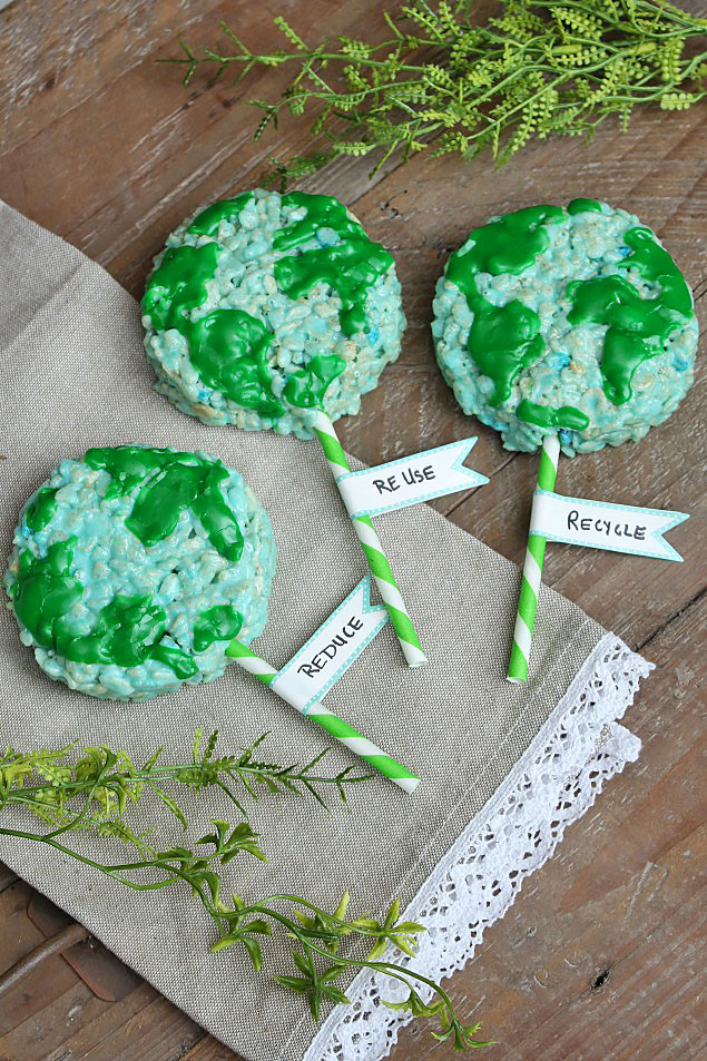 "Earth Day Recipe - fun Rice Krispie treats designed as the earth with paper straws to make them into ""pops""."
