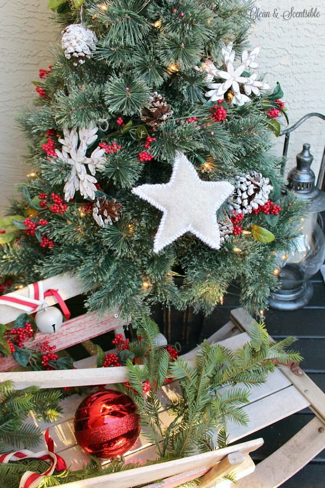 Rustic handmade Christmas star ornament using an old sweater. Beautiful decorating ideas for your Christmas porch.