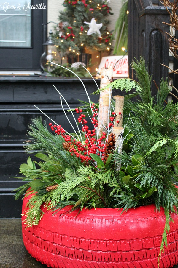 Recycled tire Christmas planter. Such a cute outdoor decorating idea for Christmas!