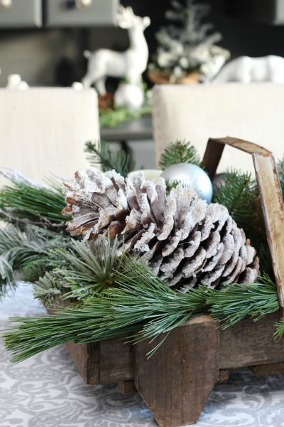 DIY icicle pinecones. All you need is a few supplies and 10 minutes to create these pretty snowy pinecones.