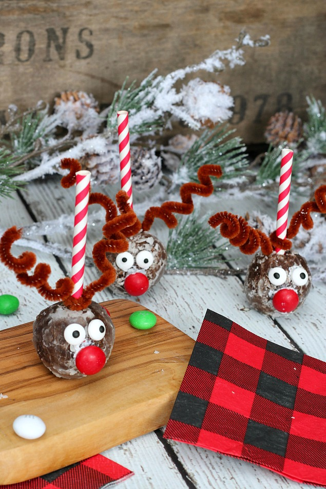 Adorable reindeer donut holes using chocolate donut holes, candy eyes and red M&Ms.