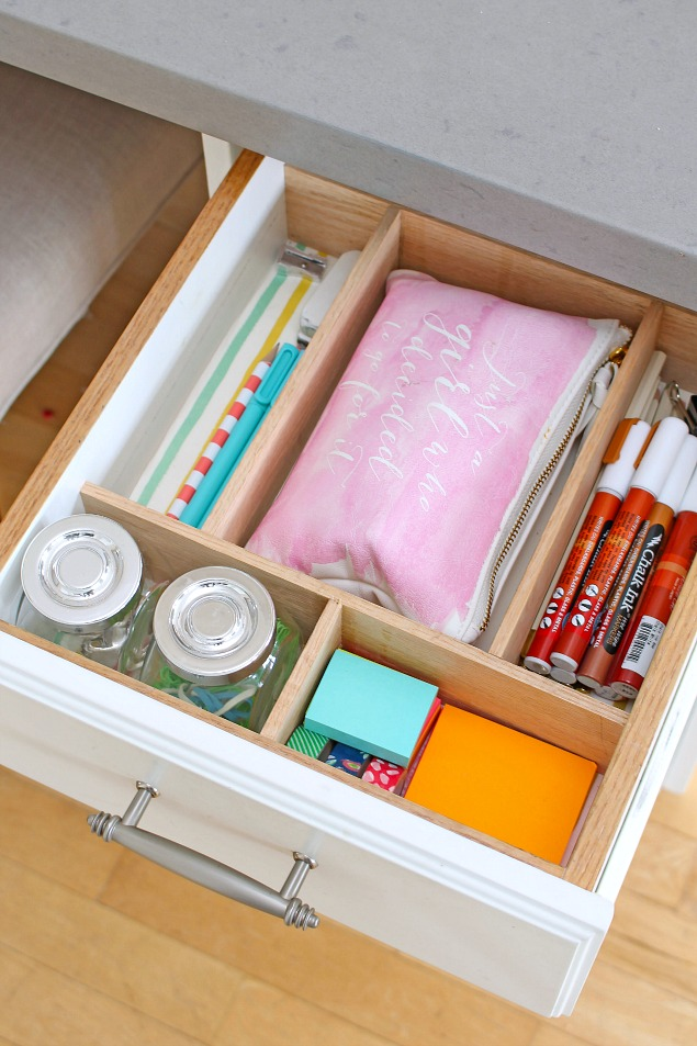 Home office organization ideas. Organized desk drawer with dividers.