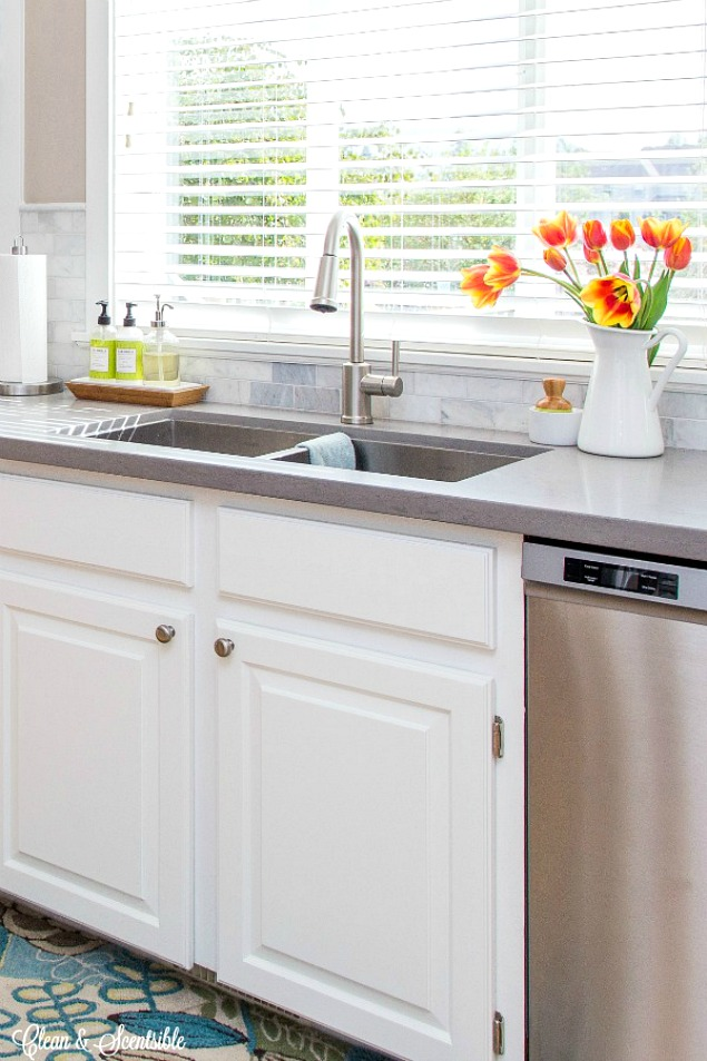 Great ideas for organizing in the awkward space under the kitchen sink.