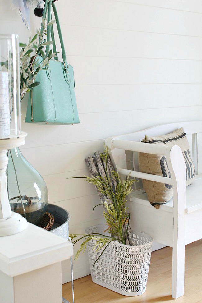 Pretty farmhouse style entryway with planked shiplap wall.