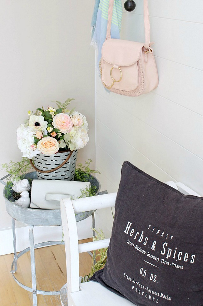 Spring entryway decorated with white and blush.
