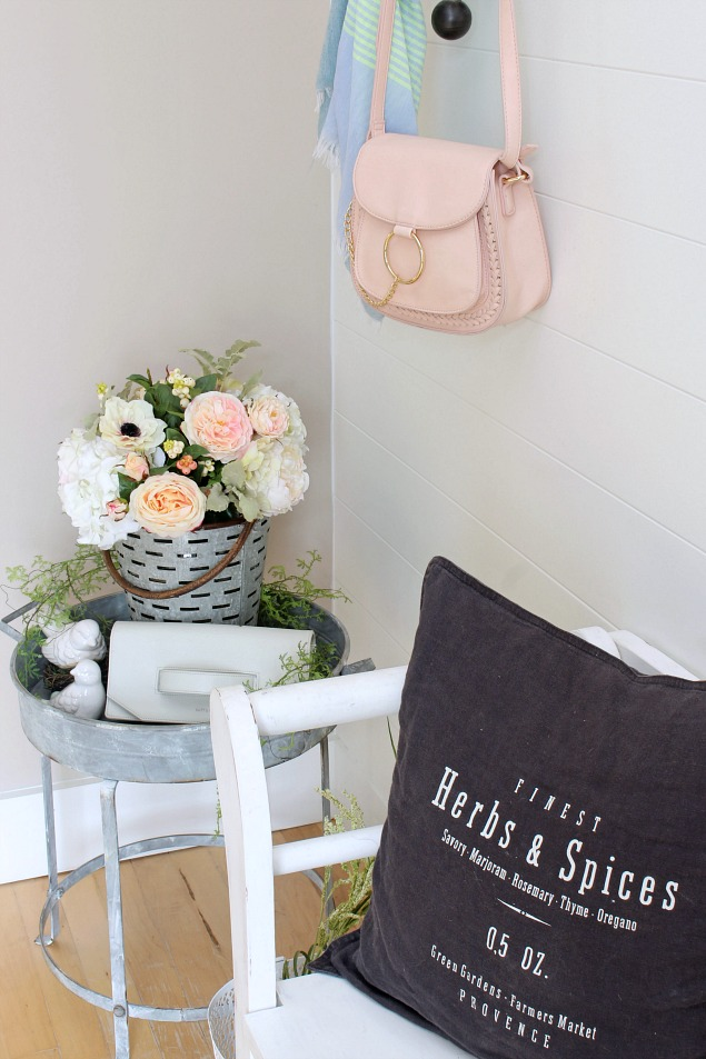 Spring decorating ideas. Pretty front entry with spring flowers.