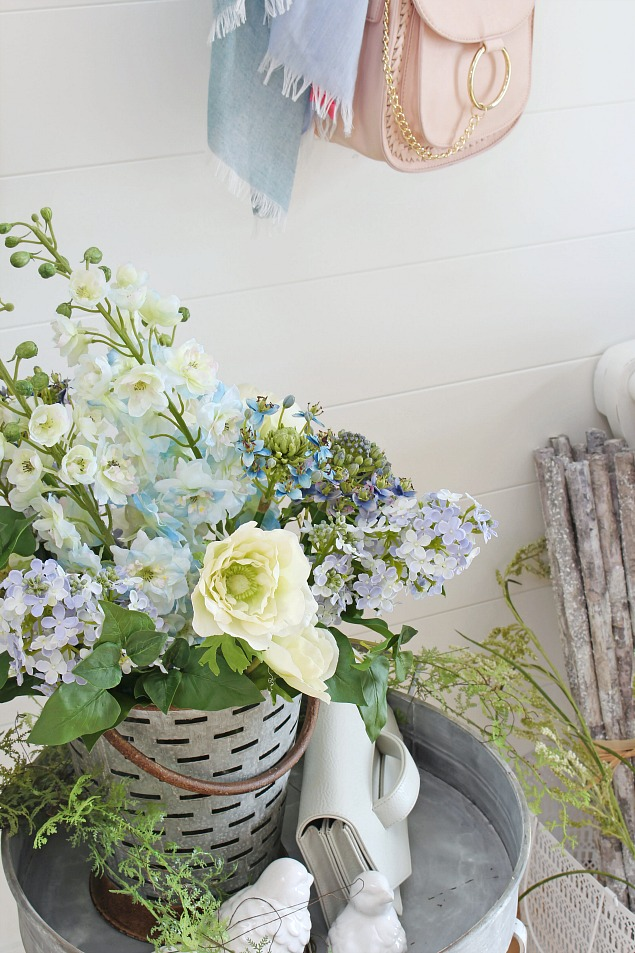 A springtime prelude decorating with faux flowers clean and spring decorating ideas pretty front entry with spring flowers mightylinksfo