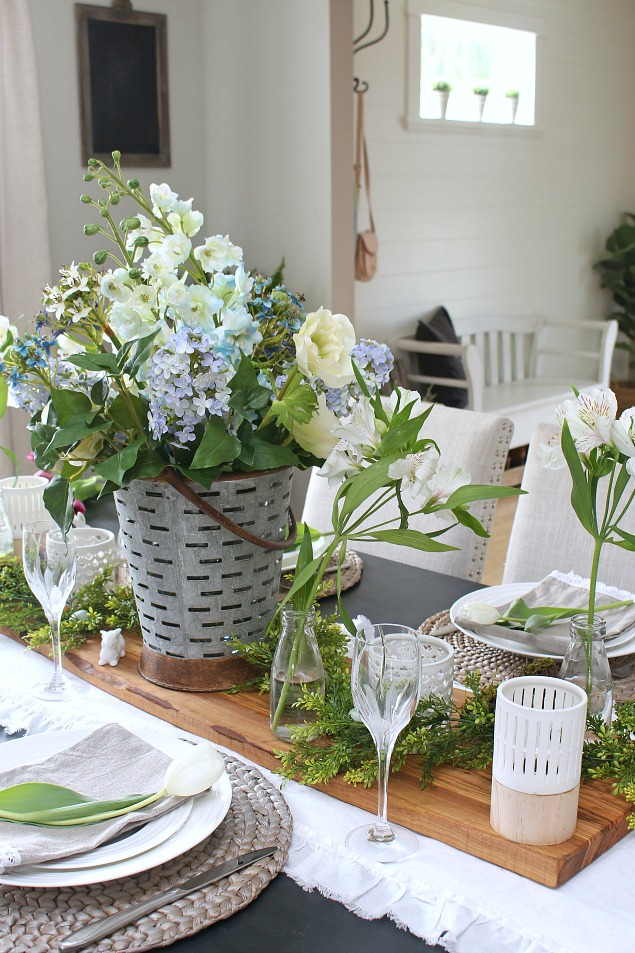 Beautiful spring decorating ideas using faux flowers. Love this pretty spring dining room.
