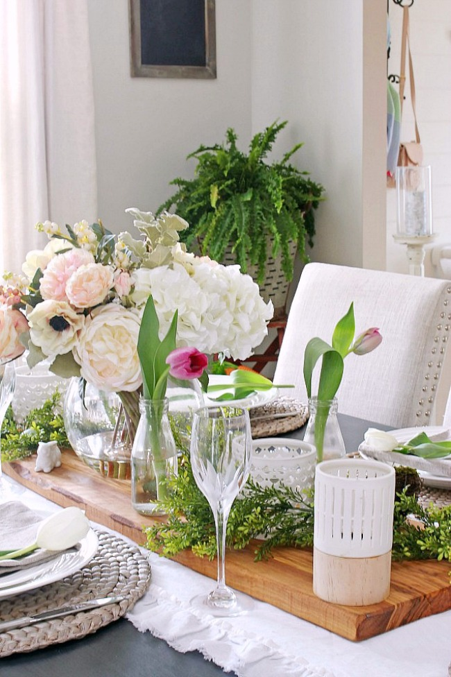 Beautiful spring centerpiece with pink and white flowers.