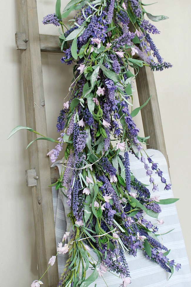 Lavender garland on a wood ladder.