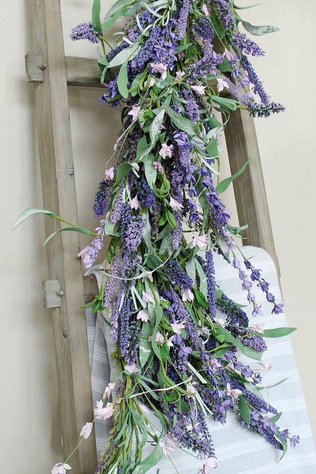 Lavender garland on a wood ladder.