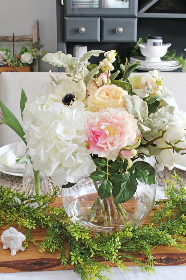 Beautiful spring centerpiece with white and pink flowers.